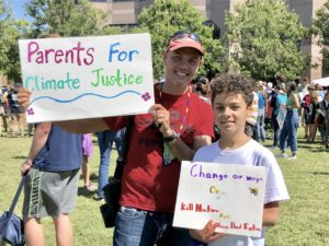 Parent with son attend a rally.