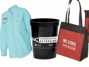 Screenshot of various promotional items, including a Columbia shirt, plastic cup and tote bag with Extension logo.