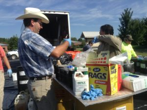 people at pesticide disposal day event