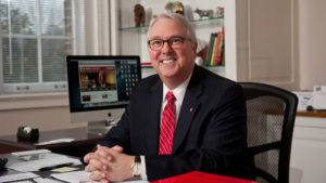 North Carolina State University Chancellor Randy Woodson sitting at a desk in his office.