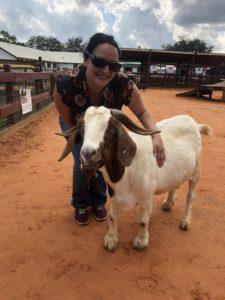 Lisa Gonzalez standing next to goat.
