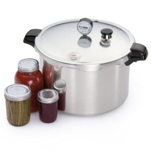 pressure canner and jars of canned vegetables