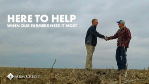two men shaking hands in a field with the text Here to Help When Our Farmers Need It Most
