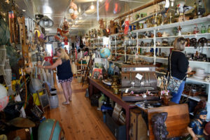 Visitors to Swansboro shop the eclectic offerings at The Poor Man's Hole antique store in the historic Onslow County town.